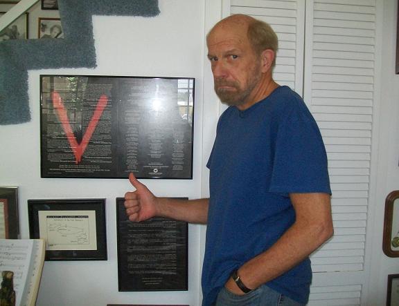 Kenny Johnson with original V artwork