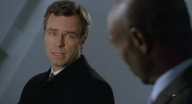 Fringe S3x12 -J.R. Bourne at CIA Agent Edwards