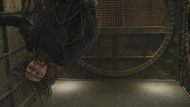 Sanctuary S3x12 Biggie hanging upside down in elevator