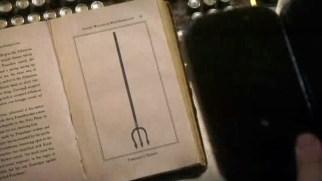 Warehouse 13 S2x12 - Image of manillan Trident in book