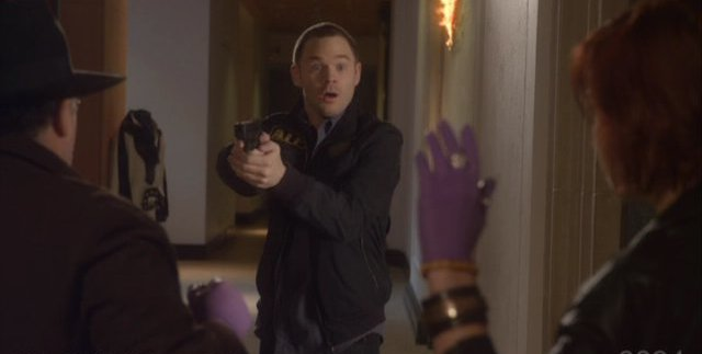 Warehouse 13 S3x01 Jinks holds them at gun point